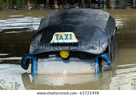Tuk-tuk taxi submerged in water during the October 2010 flooding of Nakhon Ratchasima in Thailand.