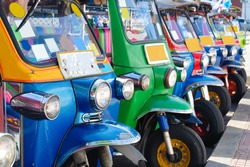 Tuk Tuk traditional taxi car fleet in Bangkok, Thailand