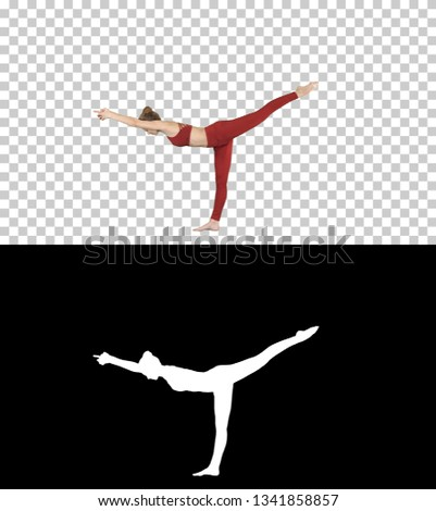 Tuladandasana or Balancing Stick Pose is an advanced yoga posture made by beautiful yogi woman, Alpha Channel