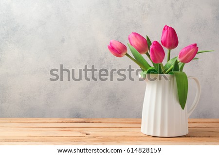 Tulip flowers bouquet on wooden table. Mothers day celebration concept