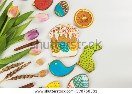 Tulips and gingerbread cookies on white background for Easter. #598758581