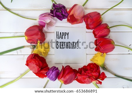 tulips flower on table with happy birthday message