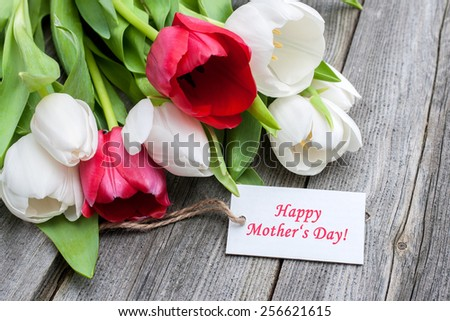 Tulips with tag and text for mother\'s day on wooden background