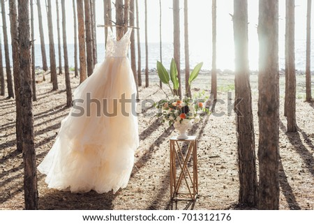 Tulle wedding dress and flower wedding decoration in boho style in the forest.  #701312176