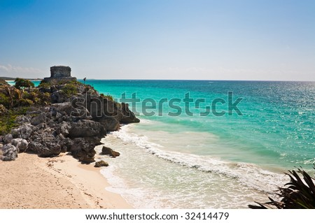 Tulum, Mexico, with Mayan ruins (El Castillo) visible on the cliffs overlooking the water.