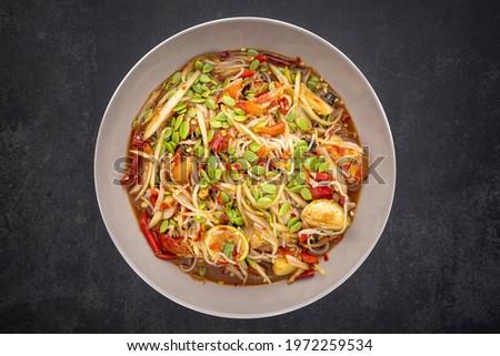 Tum Pa, Som Tum, Thai food, spicy papaya salad with Thai rice noodle, golden apple snail (Pomacea canaliculataLamarck), Leucaena leucocephala seed (Lamk seed), lime, tomato, pickled fish and chilli Zdjęcia stock ©