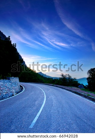 Tumbling of the road on background dawning sky