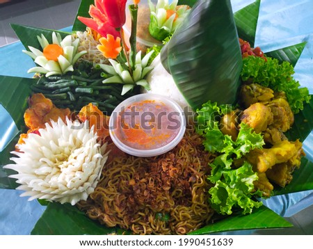 Tumpeng is one type of food that is used to celebrate someone's birthday in Indonesia