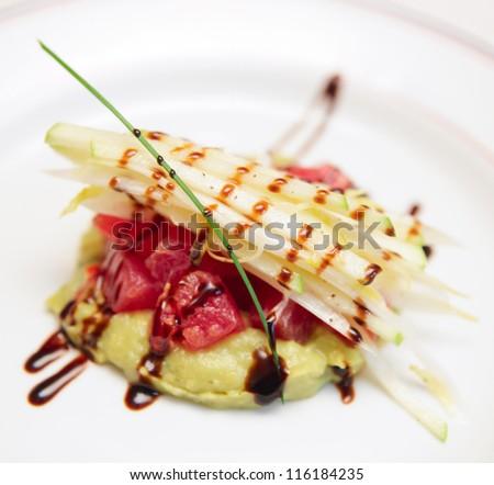 Tuna carpaccio with potato mash in plate