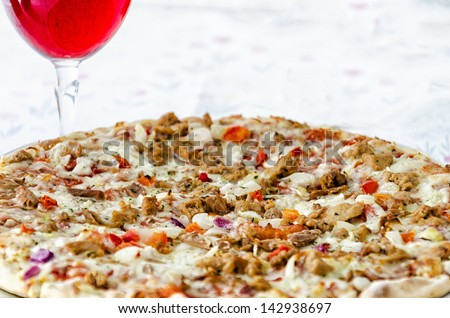 Tuna Fish Pizza with Red Wine (Shallow Depth of field- Focus on the middle part)