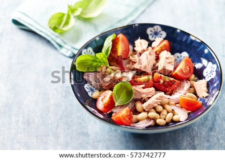 Tuna salad with cherry tomatoes, red onion, white beans, radicchio and fresh basil. Home made food. Concept for a tasty and healthy meal. Tasty snack.  Close up. Copy space. #573742777