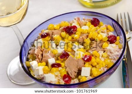 Tuna salad with feta cheese, corn and cranberries.