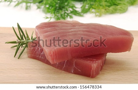 Tuna steaks and rosemary ingredient.Tuna fish slices.