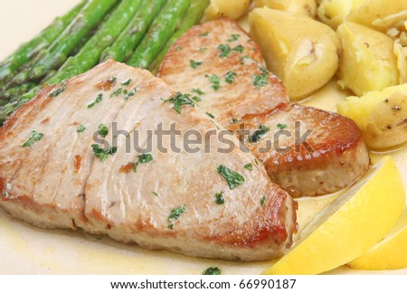 Tuna steaks with asparagus and new potatoes.