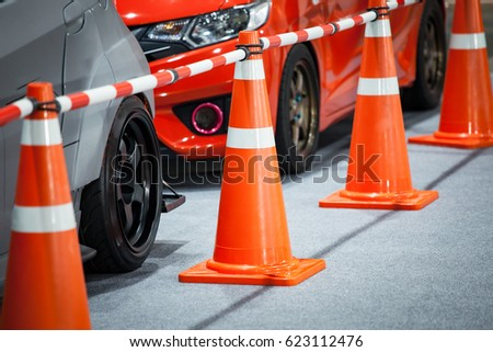 Tuned customized car in parking with cone partition #623112476