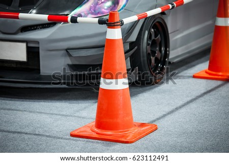 Tuned customized car in parking with cone partition #623112491