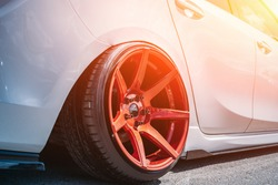 Tuned sport car wheel, close up. Low rider sport auto, toned