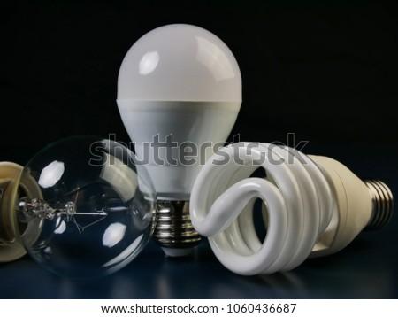 tungsten bulb, fluorescent bulb and LED bulb. Evolution of Light Bulbs For energy saving #1060436687