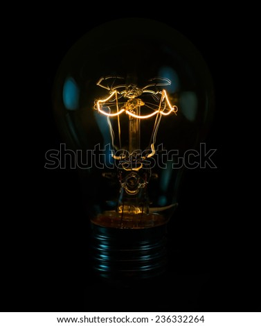 tungsten light bulb isolated on black background  #236332264