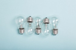 tungsten light bulbs on blue background. Old generation lamps. Incandescent lamp. Energy saver. Eco friendly. Energy-effective lamps. Reduce and save the planet. Top view