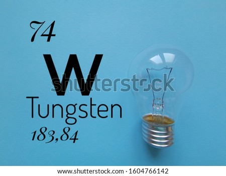 Tungsten, or wolfram, is a chemical element with the symbol W and atomic number 74. The symbol W with atomic data (atomic number and atomic mass) and tungsten bulb in the background.