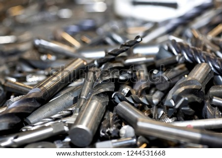 Tungsten tools. a Drills covered with tungsten.
