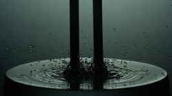 Tuning Fork in Water vibrating musical note with droplets reverberating
