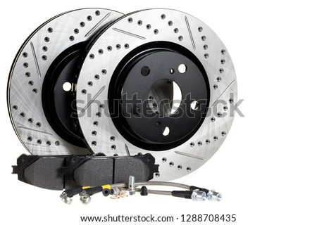 Tuning the brake system of the car. Perforated brake discs, ceramic pads and reinforced hoses - all for better braking.brake disc, pad and reinforced brake hose on a white background