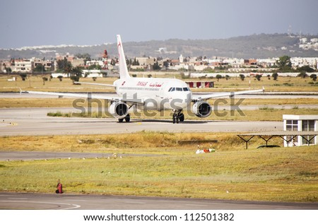 TUNIS, TUNISIA - JUL 15: Airplane Airbus A320 in the Carthage International Airport (Tunisair flies to destinations across Africa, Asia and Europe) on July, 15 2012 in Tunis.