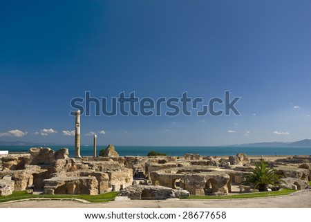Tunisia. Ancient Carthage. General view of Antonine Baths - ruined caldarium (the hottest room) and steamroom on first plan, large column from frigidarium on left - stock photo