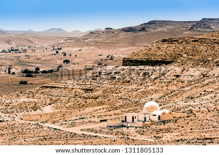 TUNISIA (SOUTH-TUNISIA). THE ROAD OF THE KSOUR (REGION OF TATAOUINE). THE FORMER BERBER VILLAGE (KSAR) OF DOUIRET. HOUSE IN A DESERT #1311805133