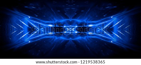 Stock Photo Tunnel in blue neon light, underground passage. Abstract blue background. Background of an empty black corridor with neon light. Abstract background with lines and glow
