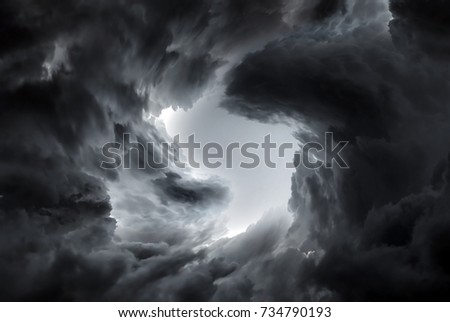Tunnel in the Dark and Dramatic Clouds