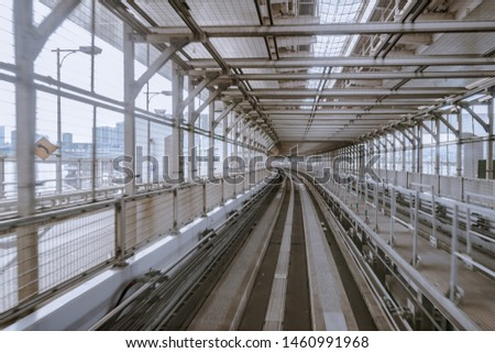 """tunnel of monorail road view from front window of a moving train running. The Japanese means """"alerts, diversions"""" #1460991968"""