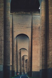 Tunnel or a passage with a series of tall arches and bike lane in NYC