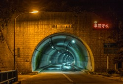 Tunnel, Toyama, Japan. TRANSLATION OF JAPANESE TEXT: use lights in tunnel; Asahi ogawa tunnel; keep your distance; length 1316m; emergency phones every 200m; call buttons, 50m; extinguishers, 50m.