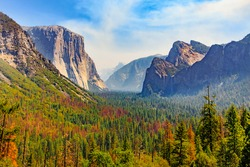 Tunnel View of scenic Yosemite Valley with famous El Capitan, Half Dome rock climbing summits, and and Bridalveil Fall in summer, Yosemite National Park, California, United State of America
