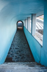 tunnel with stairs with oval shapes in blue