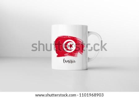 Tunusia flag souvenir mug on white background. 3D rendering. Foto stock ©