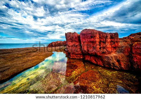 Tura red rocks, situated at Tura headland in the far south coast of NSW Australia these rocks dating over 300 million years form a beautiful backdrop to Tura beach, a great spot for fishing and Photos