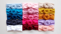 Turban fashion bandana hair accessories isolated with turban woman fashion style on mannequin head band. This fancy hairband design with donut or doughnut is very casual and stylish for headband girl.