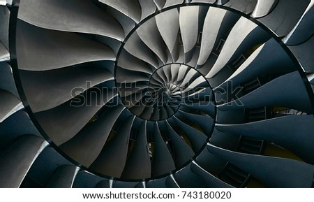 Turbine blades wings spiral effect abstract fractal pattern background Spiral industrial production metallic stair background Turbine manufacturing technology abstract fractal pattern staircase