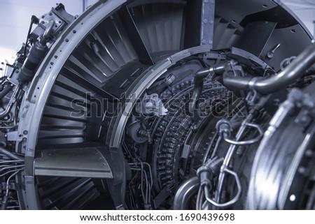 Turbine Engine. Aviation Technologies. Aircraft jet engine detail during maintenance. Blue toned.