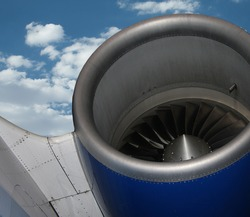 turbine jet motor and part of the wing of a commercial airliner