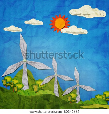 Turbine to produce electricity on blue sky created by recycle paper craft stick.