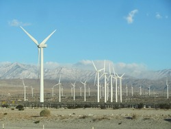 Turbines from a giant wind farm dot the landscape near Palm Springs, CA.