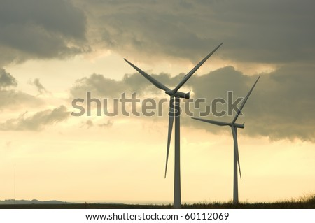 Turbines on a wind farm at sunset in Scottish summer