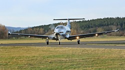 Turboprop aircraft on the runway at small airport
