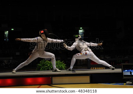 TURIN - FEB 7: Women Foil World Cup, Chinese fencer CHEN Jinyan fight against german fencer BINGENHEIMER Sandra during semifinal match of team tournament on  February 7, 2010 in Turin, Italy.