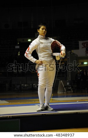 TURIN - FEB 7:  Women Foil World Cup, Chinese fencer CHEN Jinyan stands during a break of semifinal match of team tournament on  February 7, 2010 in Turin, Italy.